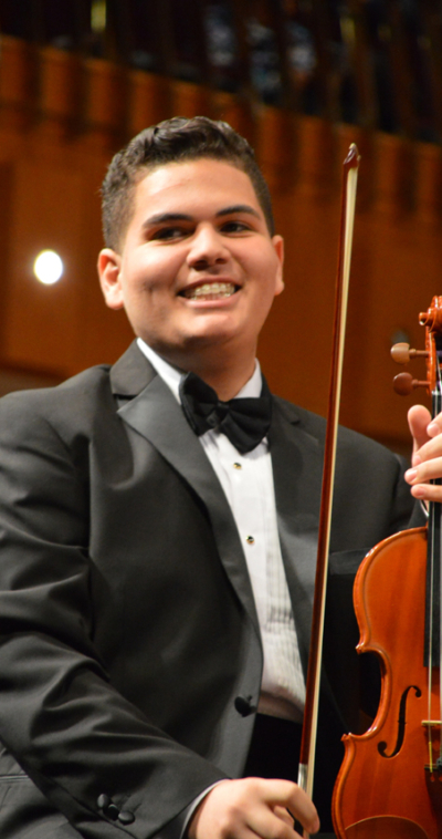 javier torres violin player with the icopr